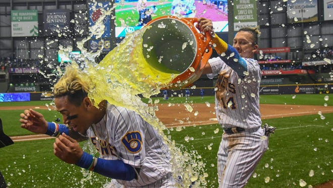 Brewers shortstop Orlando Arcia gets a Gatorade bath after his game-winning hit vs. the Cubs on Friday night at Miller Park.