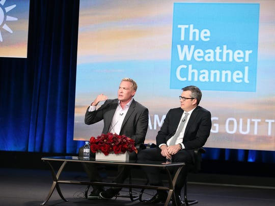 David Clark of The Weather Channel and anchor and managing editor Sam Champion speak onstage during the 2014 Winter Television Critics Association tour.