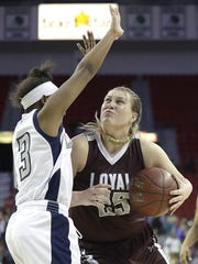 Loyal High School's Karsyn Rueth drives to the basket