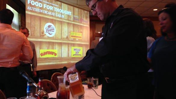 Trey Litel, president of Louisiana Spirits, pours samples