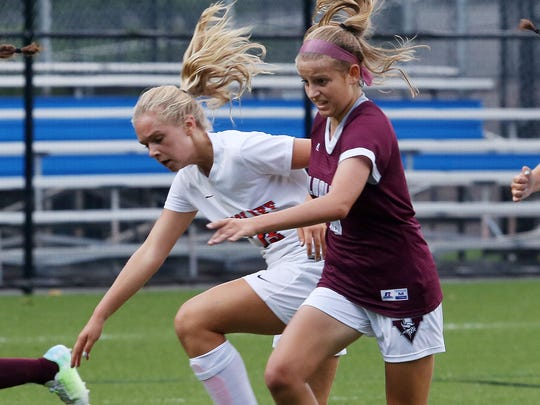 From left, Briarcliff's Caitlyn Dornau (13) and Valhalla's Allison Portera (6) battle for ball control during girls soccer action in the Mount Pleasant Cup Tournament at Briarcliff High School on Sept. 7, 2017. Briarcliff won the game 5-4 in overtime.