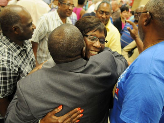 Ollie Tyler get a hug from the audience after the first forum for Shreveport mayoral candidates event at Southwood High School Tuesday evening.