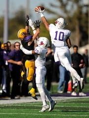 Linfield defensive back Skylor Elgarico (10) breaks up a pass intended for Hardin-Simmons wide receiver Reese Childress (21) during the fourth quarter of the Cowboys' 24-10 loss in the first round of the NCAA Division III playoffs on Saturday, Nov. 19, 2016, at HSU's Shelton Stadium.