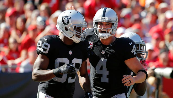 Raiders quarterback Derek Carr, right, threw for 513 yards and four TDs in Week 8 Wide receiver Amari Cooper, left, had 173 yards and a score.