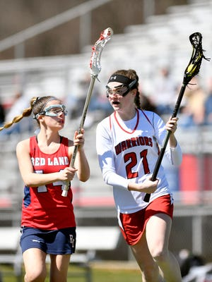 Susquehannock's Maggie Howells, right, drives against Red Land's Camille Lawler in the second half of a high school girls' lacrosse game Saturday, March 31, 2018, at Susquehannock. Susquehannock, which won its first-ever district title last year, defeated Red Land 20-1 in its second game of the season.