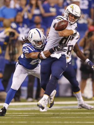 Indianapolis Colts strong safety Clayton Geathers (26) strips San Diego Chargers tight end Hunter Henry (86) late in the game at Lucas Oil Stadium on Sept. 25, 2016. The Colts recovered.