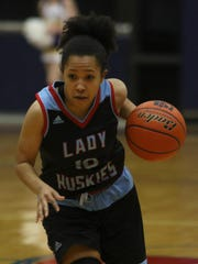 Hirschi's Jania Vinson drives to the basket in the Region I-4A bi-district playoff against Abilene Wylie Monday, Feb. 13, 2017, in Graham. Wylie defeated Hirschi 65-46.