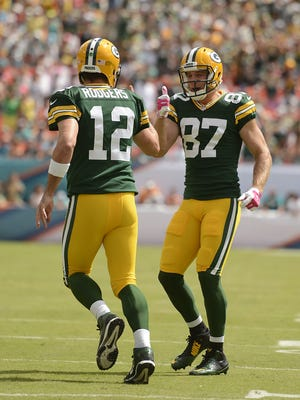 Green Bay Packers receiver Jordy Nelson gives a thumbs-up to teammate Aaron Rodgers after the two connected for a touchdown against the Miami Dolphins at Sun Life Stadium.