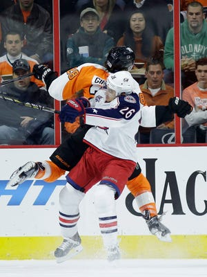 The Flyers' Claude Giroux and Columbus Blue Jackets' Corey Tropp collide during the first period Friday in Philadelphia.