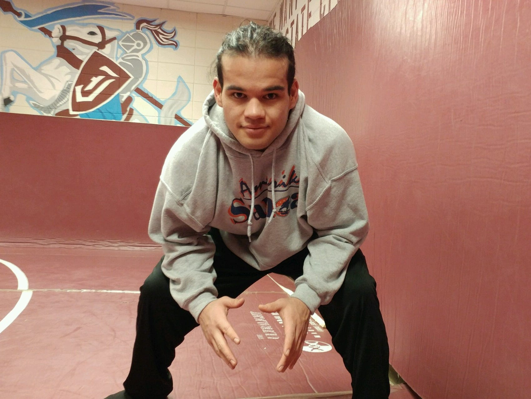 Jeffersontown High School senior wrestler Lawrence Malala is ranked No. 2 in the state in the 220-pound weight class.