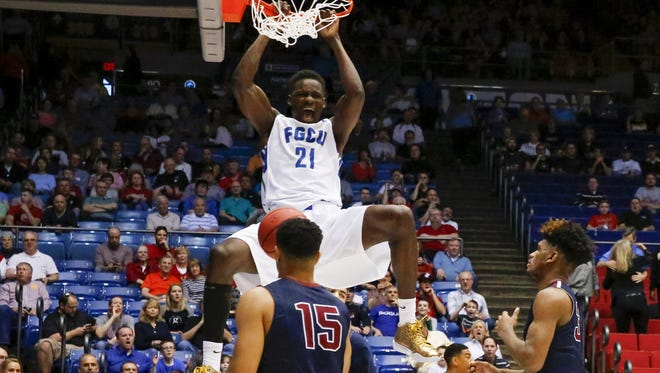 Demetris Morant dunks in front of Fairleigh Dickinson's Mike Holloway during Tuesday's NCAA tournament first-round win.