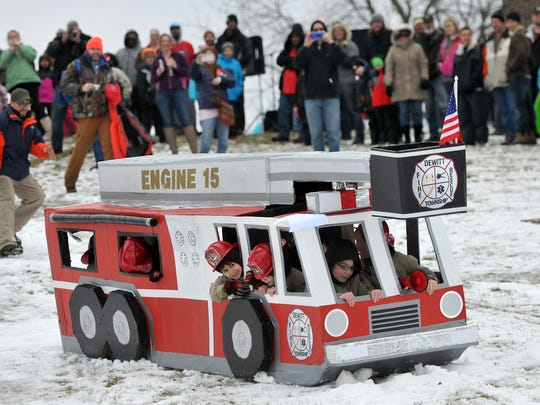 DeWitt Cub Scout Pack 15 packed 18 scouts in this cardboard sled fire engine in the 9th annual Cardboard Classic Saturday, January 24, 2015.