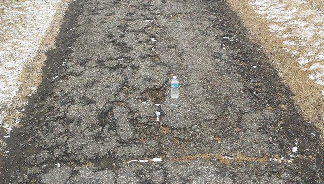 Deteriorating asphalt on the Elks Path trail on the northeast end of Riverside Park