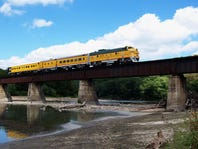 f0714datebookdiner -- The historic dinner train of the Boone Scenic and Valley Railroad, crosses over the Des Moines bridge on one of its dining trips. Photo/Boone & Scenic Valley Railroad