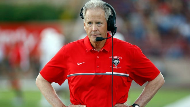 New Mexico coach Bob Davie walks in the sideline during his team's game against New Mexico State.