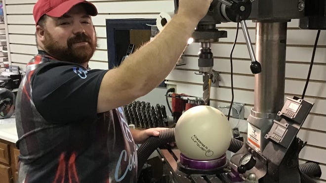 New Landmark Lanes pro shop manager Tony Schnack gets set to drill a bowling ball at the Peoria bowling center.