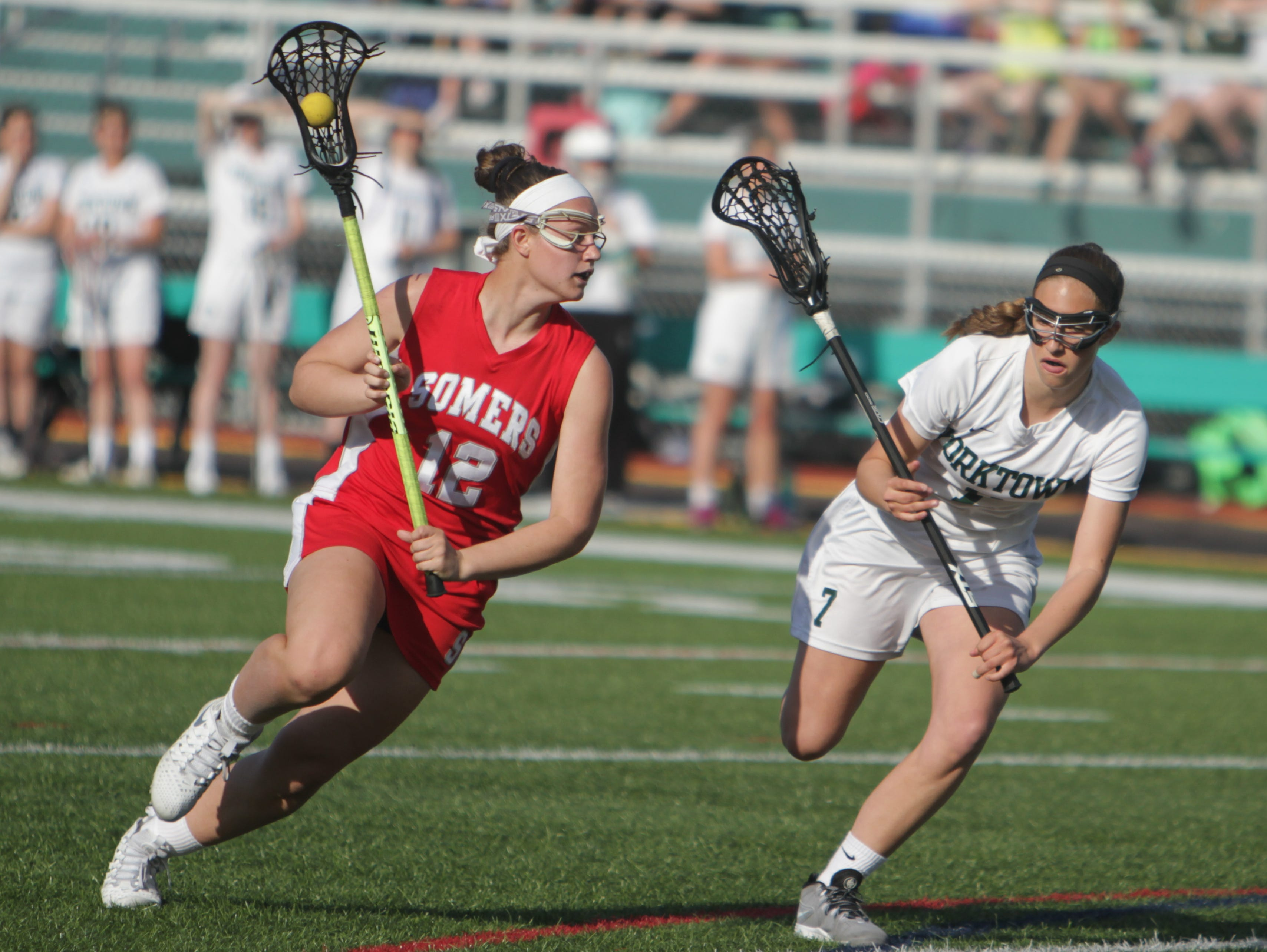 Action during a Section 1 girls lacrosse game between Yorktown and Somers at Yorktown High School on Thursday. Somers won 11-10.