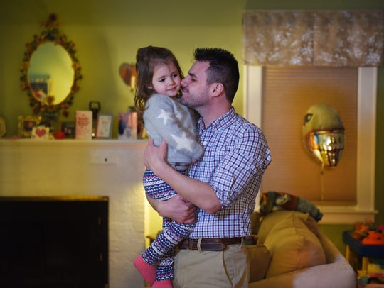 Photo of Jim Villanella and his 2-year-old daughter Isabelle, at their home in Verona. March 3rd will mark one year since the death of Megan Villanella in Verona.