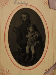 William Henry Hanks holds his daughter, Charlotte,