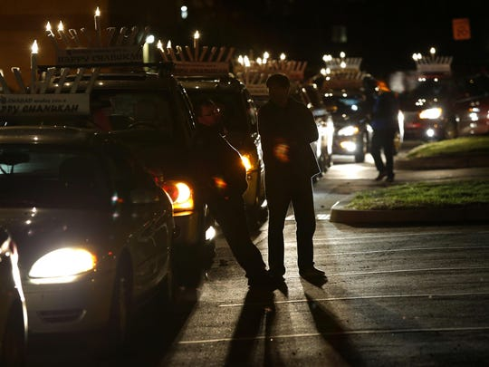 Participants wait Monday evening for the start of the annual Marlboro car menorah parade, which starts at Menzel Road and ends at Marlboro Plaza on Route 9.