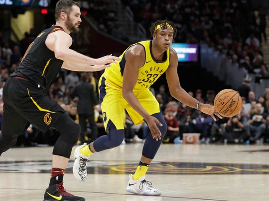 Indiana Pacers' Myles Turner (33) passes against Cleveland