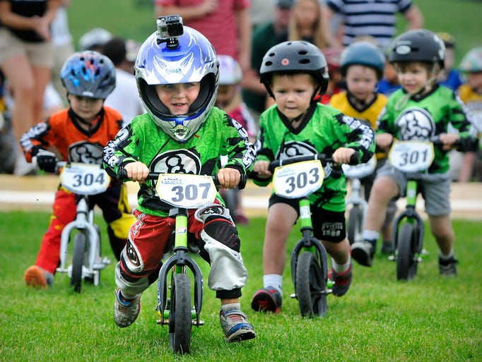 Cullen Kangas (307) leads the pack in a race in the three-year-old division during Saturday's Strider Championship Series event at Lake George in St. Cloud.
