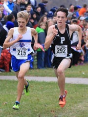 Plymouth's Ethan Byrnes (right) goes stride for stride
