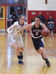 Roy C. Ketcham's Katie Wall drives down the court against