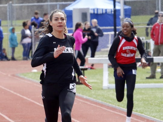 Breana Gambrell of Athens runs to a win in the 200-meter