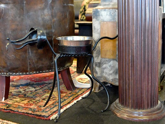 A unique water bowl holder is ready for furry customers at the Battery Park Champagne Bar and Book Exchange.