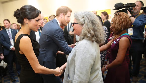 Markle perfecting her royal handshake.