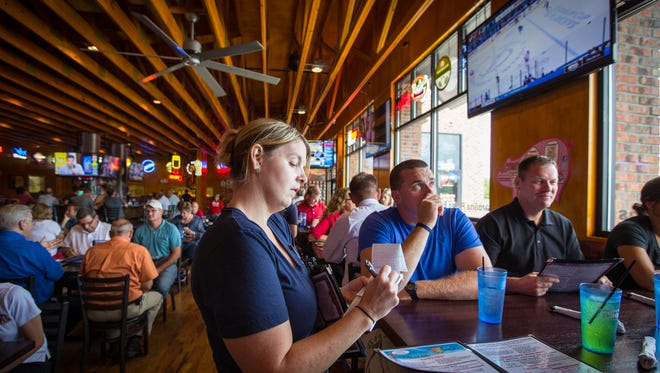 Server Wendy Becvar works the lunch crowd at Jethro's BBQ n' Pork Chop Grill in Johnston Tuesday July 12, 2016. By working a tipped job, she says she makes more per hour than her previous hourly work as a CNA.