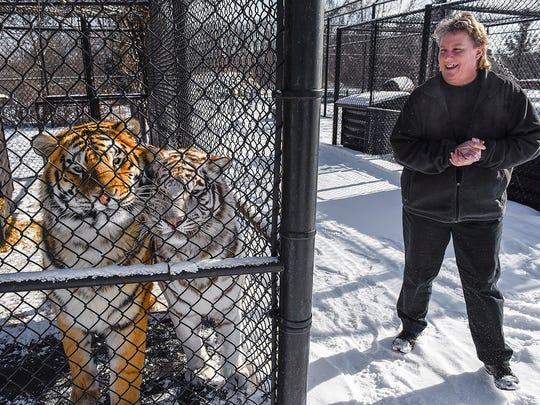 Zoo director Marnita Van Hoecke checks on the tigers