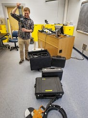 Peter Isles shows a six-sensor sonde and other water-sampling
