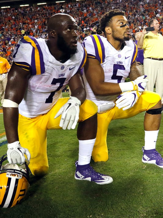LSU running back Leonard Fournette (7) and running back Derrius Guice (5) watch and wait for the review that ended the game with a loss to Auburn in an NCAA college football game, Saturday, Sept. 24, 2016, in Auburn, Ala. (AP Photo/Butch Dill)
