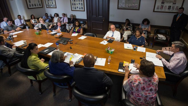 Members of the Democratic Caucus of Louisville Metro Council meet inside City Hall on Thursday. June 15, 2017