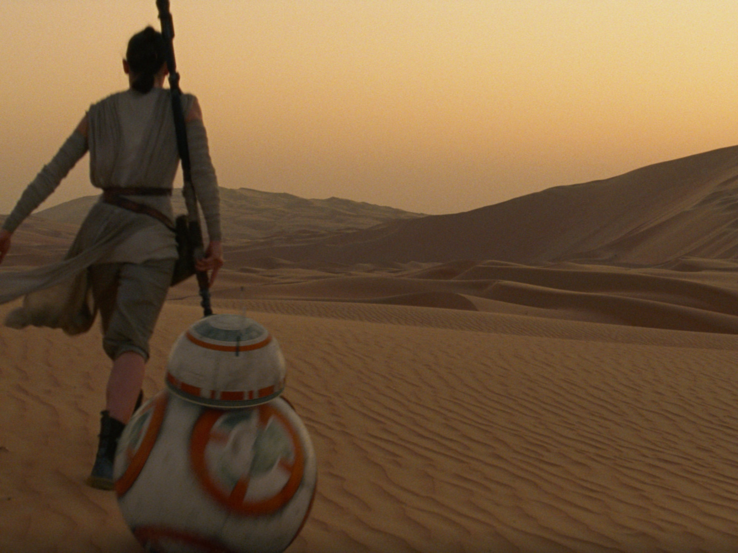 """Rey and BB-8 wheel it through a desert planet scape in """"Star Wars: The Force Awakens."""""""