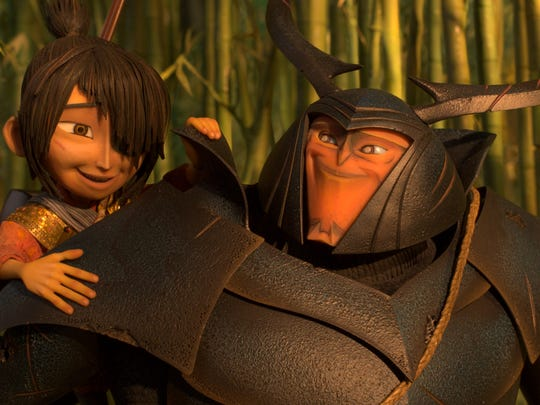 Kubo (voiced by Art Parkinson) gets a lift from his