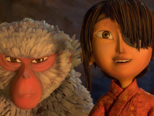 """Kubo, voiced by Art Parkinson, right, and Monkey, voiced by Charlize Theron in a scene from the animated film, """"Kubo and the Two Strings."""""""