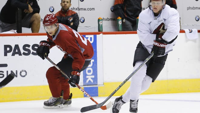 Arizona Coyotes Dylan Strome (left)  and Christian Dvorak take part in rookie camp Saturday, Sept. 17, 2016 in Glendale.