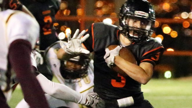 El Paso High's Matt Teran, 3, gets around an Andress defender Friday night.