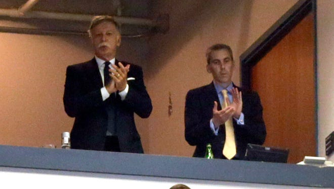 A lawsuit filed alleges Rams owner Stan Kroenke (left) and COO Kevin Demoff lied about their desire to keep the team in St. Louis.