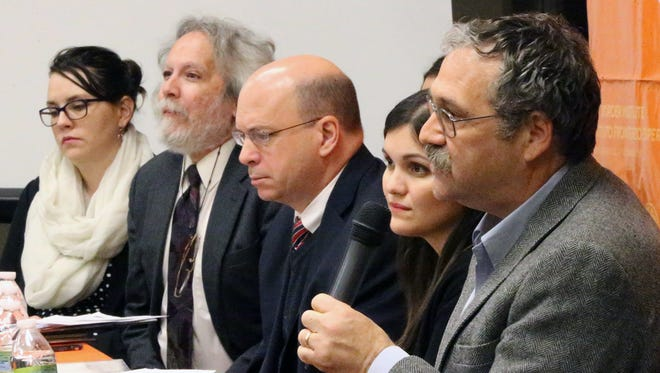 """Josiah Heyman, right, a professor and director of the Center for Inter-American and Border Studies at UTEP, was part of a panel that spoke on a report titled, """"Sealing the Border: The Criminalization of Asylum Seekers in the Trump Era,"""" on Thursday at UTEP."""