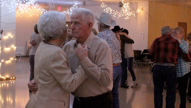 Couples dance at the Country-Western Live Band Dance featuring The Red Door Band Friday, Jan. 26, 2018, in the 50 Plus Zone at the Wichita Falls Public Library.