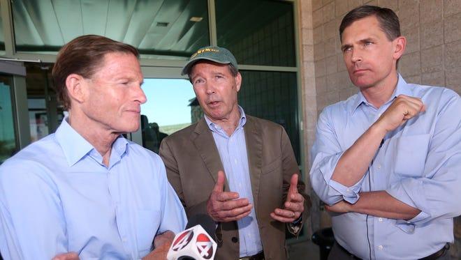 U.S. Senators Richard Blumenthal, D-CT, left, Tom Udall, D-NM, center, and Martin Heinrich, D-NM talk to the media outside the U.S. Border Patrol station at 9201 Gateway South Blvd. Friday.