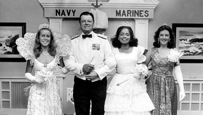 The Navy's annual Cotton Carnival Ball on the air staion in Millington on 26 May 1978 paid tribute to the royalty from the Cotton Carnival and Cotton Maker's Jubilee.  Cotton Carnival Queen Mimi Fuller (Left), Jubilee Queen Gwendolyn Jackson (Second Right) and Navy Princess Katherine Ketchum (Right) are escorted by Rear Adm Lando W. Zech Jr., Chief of Naval Technical Training.