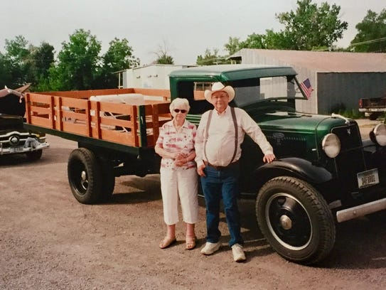 Robert and RoseMary Snodgrass poss with her father's 1934 truck, which Robert spent three years restoring.