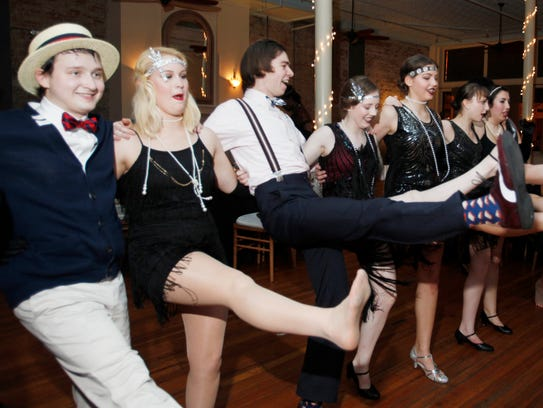 Asheville School students do a kick line on the dance