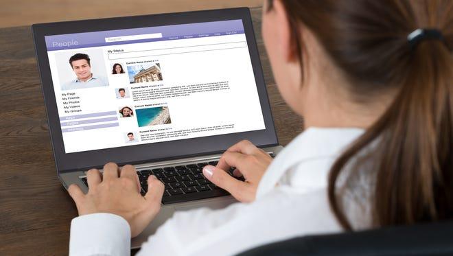 A woman chants on a social website.