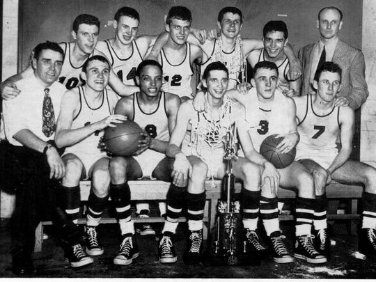 The 1948 state champion basketball team from Jefferson High School. Back row: Bill Kiser, Ned Snyder, Jim Lucus, Dick Robinson, Earl Heninger and assistant coach Sam Lyboult. Front row: (l to r) Marion Crawley, Dan Casey, Ernest Hall, Bob Masters, Joe Mottram and Charles Vaughan